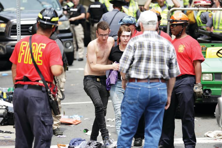 """הדריסה בשרלוטסוויל. """"יש אלימות משני הצדדים"""". צילום: רויטרס"""