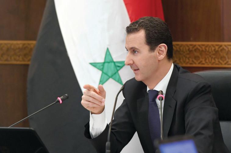 אסד. הצבא שלו מעודד מניצחונותיו. צילום: AFP