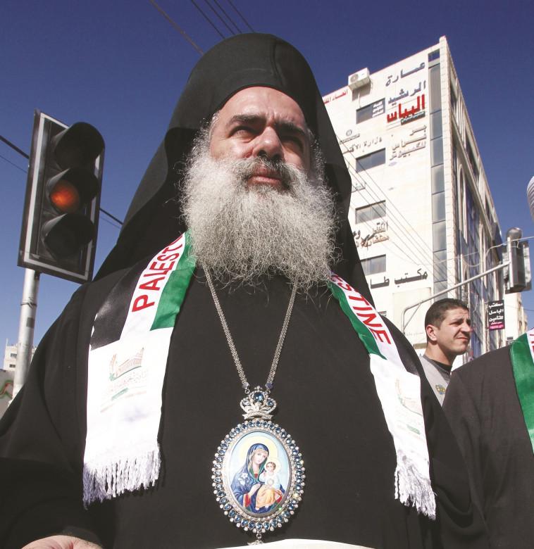 חובר לאוייבי ישראל. עטאללה חנא, צילום: AFP