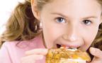 ילדה אוכלת מתוקים, אילוסטרציה