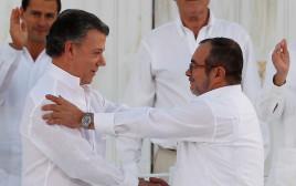 נשיא קולומביה חואן סנטוס וראש ה-FARC רודריגו לונדונו