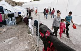פליטים בכיוס