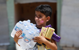 ילד במוסול לאחר שחרור התושבים מידי דאעש
