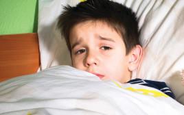 ילד שוכב במיטה, אילוסטרציה