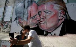 ציור גרפיטי בגדר ההפרדה בבית לחם