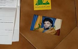 מסמכים ותמונות שנמצאו אצל חשודים בקשרים עם חיזבאללה בארגנטינה