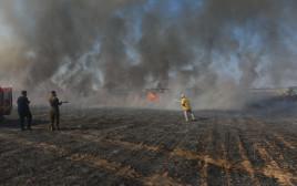 הצתה כתוצאה מבלוני תבערה סמוך לנחל עוז