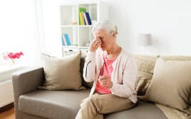אישה חולה, אילוסטרציה (למצולמת אין קשר לנאמר בכתבה)
