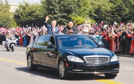 קים ונשיא קוריאה הדרומית בנסיעה בפיונגיאנג