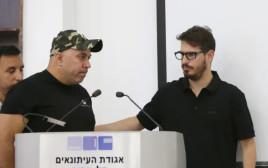 חוגג ונציג הארגון במסיבת העיתונאים