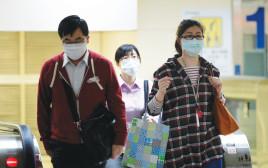 מסתובבים עם מסכות פנים בסין