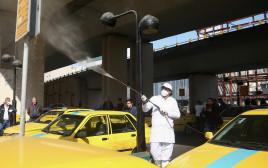 חיטוי תחחנת מוניות בטהרן בגלל נגיף הקורונה