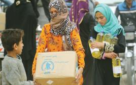 נשים מקבלות סיוע במזון מהארגון, ארכיון (למצולמות אין קשר לנאמר בכתבה)