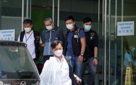 """פשיטה על ה""""אפל דיילי"""" בהונג קונג"""