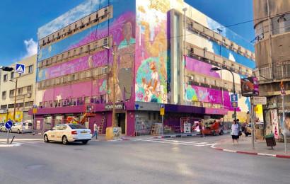 """בניין המשביר מקושט בגרפיטי. (צילום: יח""""צ)"""