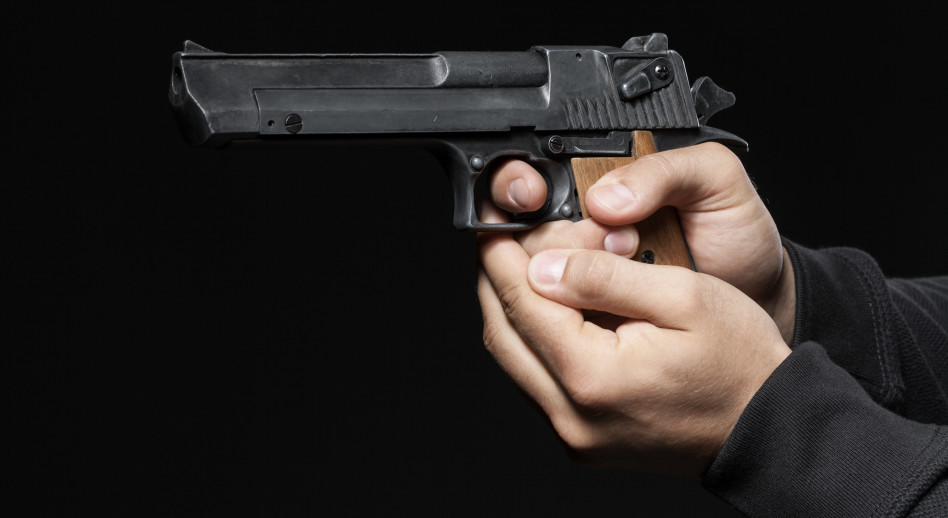 גבר עם אקדח (אילוסטרציה)