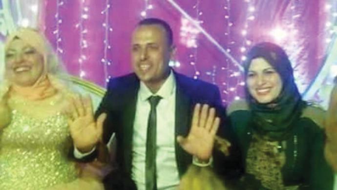 מועתז הילאל עם שתי נשותיו