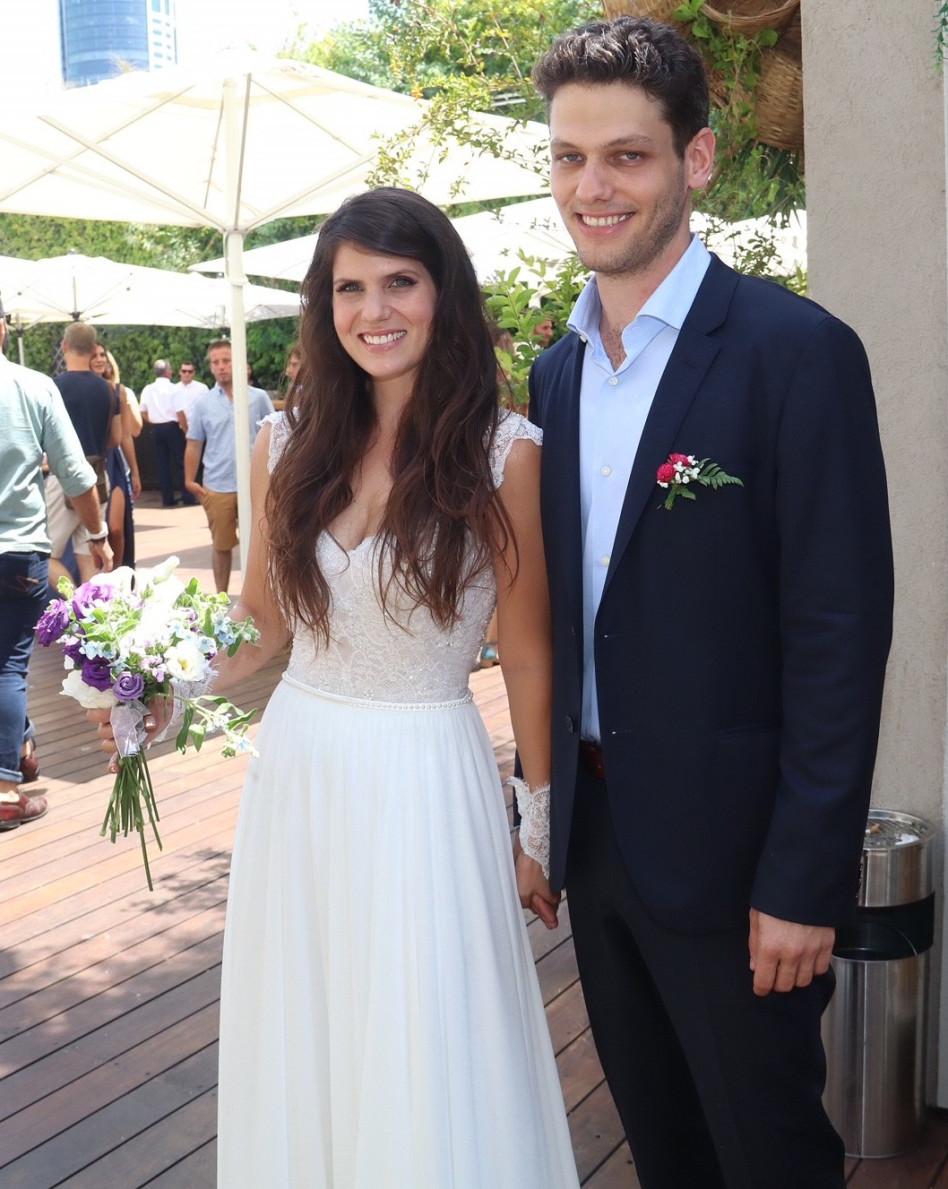 דנה וישינסקי ודניאל שוהם ביום חתונתם (צילום: אביב חופי)