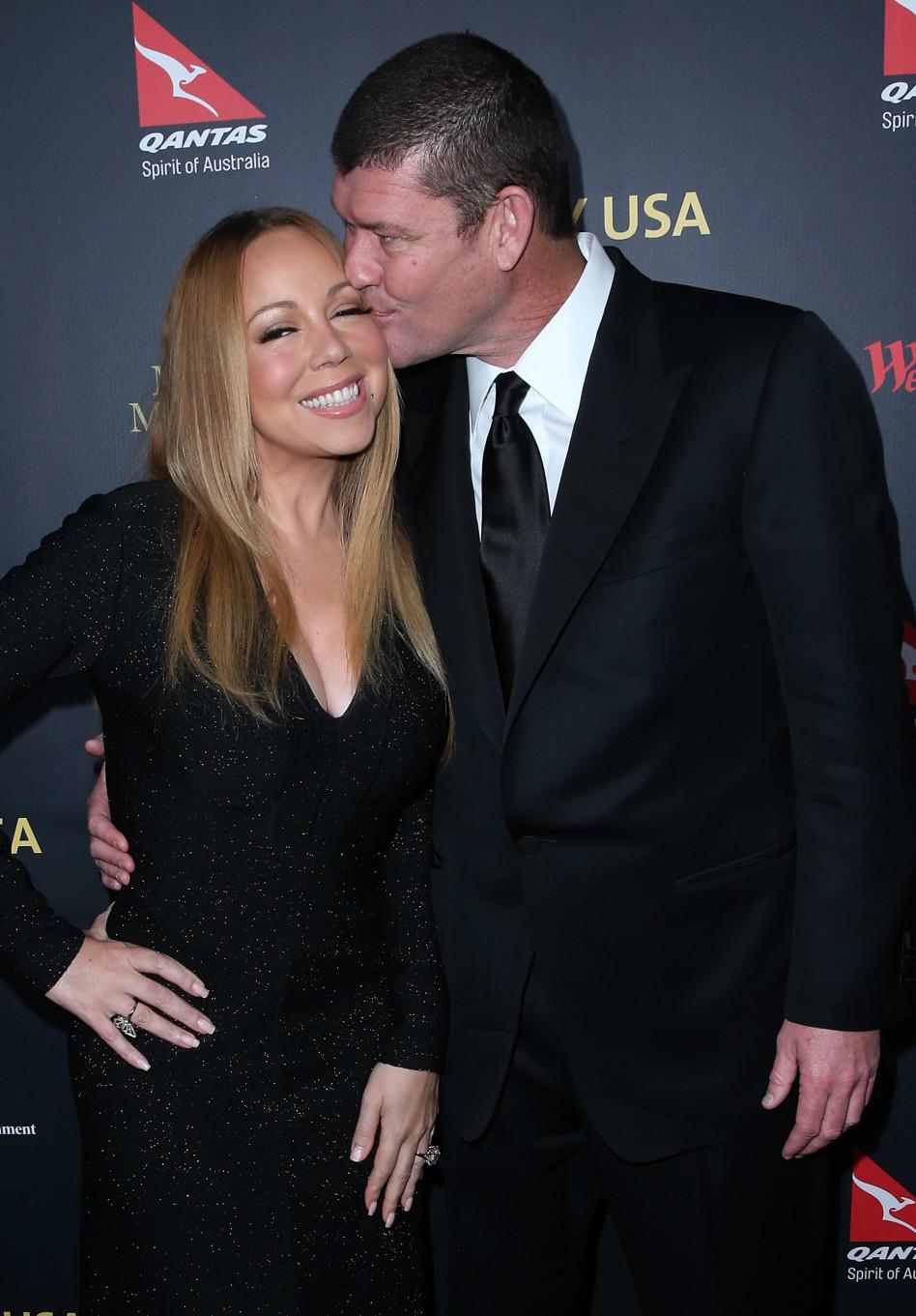נשיקה, זה כל מה שהוא יקבל! מריה קארי וג'יימס פאקר (גטי)