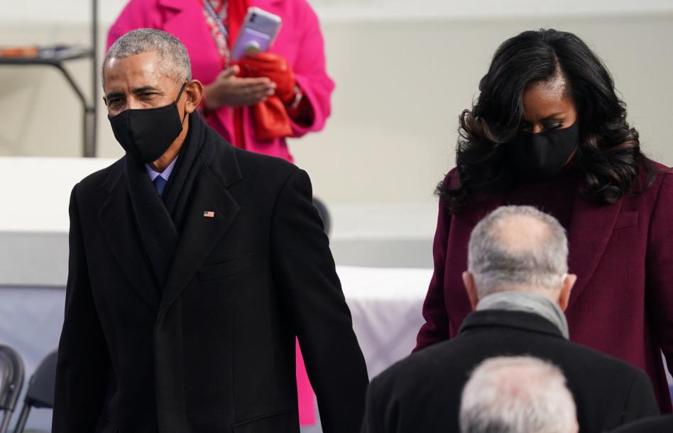 ברק ומישל אובמה מגיעים להשבעת ביידן (צילום: REUTERS/Kevin Lamarque)
