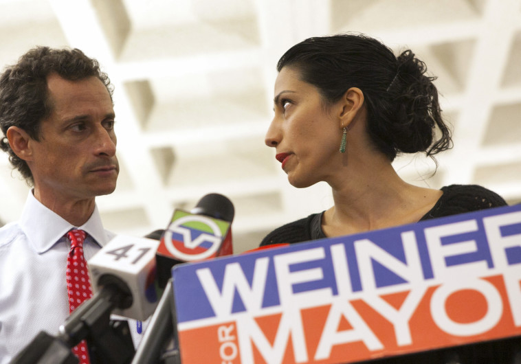 אנתוני וינר ואשתו בנפרד הומה אבדין. צילום: רויטרס