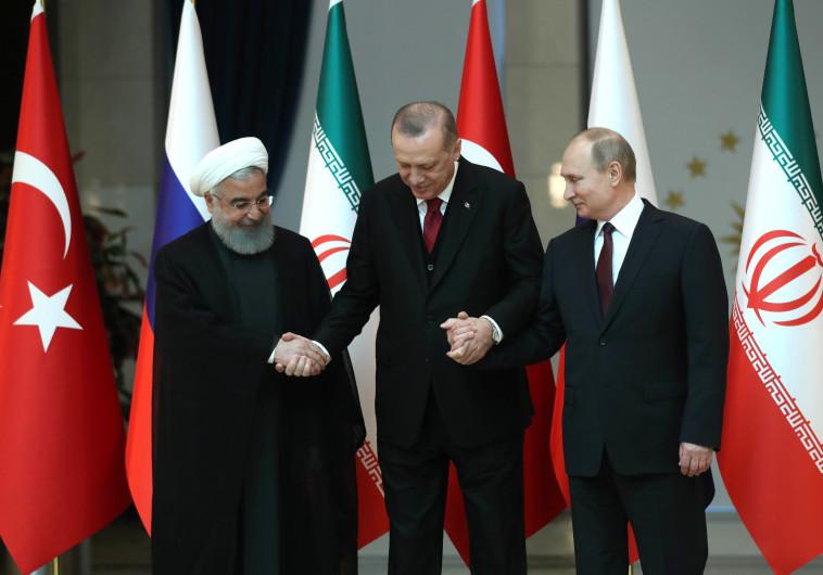 ולדימיר פוטין, ארדואן חסן רוחאני. צילום: AFP