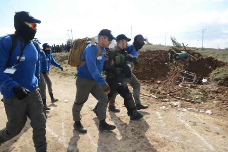 """שוטר מג""""ב שיסרב פקוה בפינוי עמונה. צילום: תצפית TPS"""