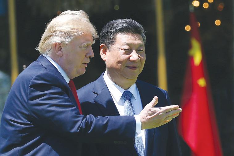 דונלד טראמפ ונשיא סין שי ג'ינפינג. צילום: רויטרס