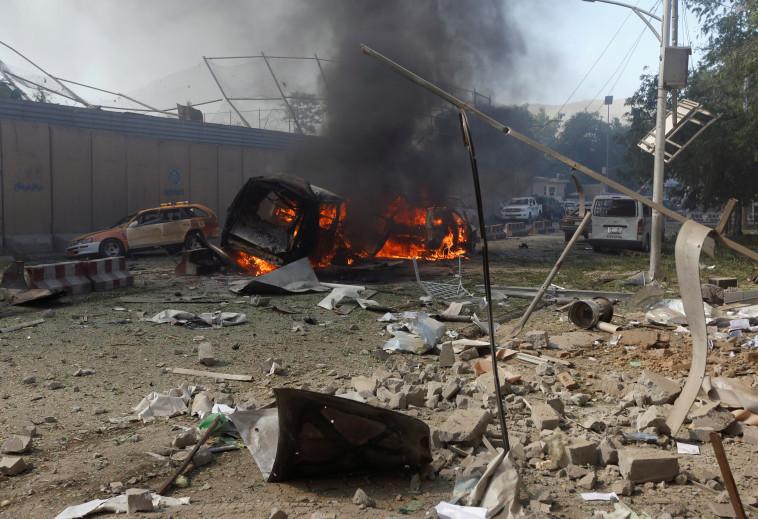 """""""הרגיש כמו רעידת אדמה"""", הרס וחורבן בזירת הפיגוע. צילום: רויטרס"""