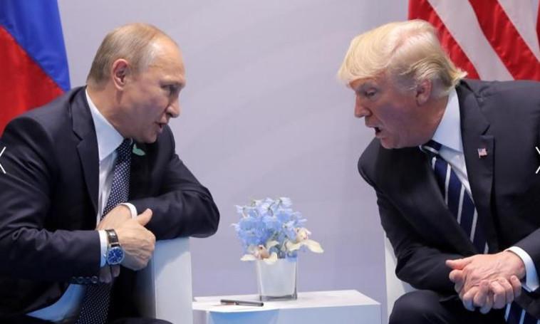 טראמפ עם פוטין. צילום: רויטרס