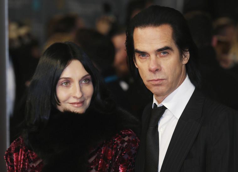 ניק קייב ואשתו. רויטרס