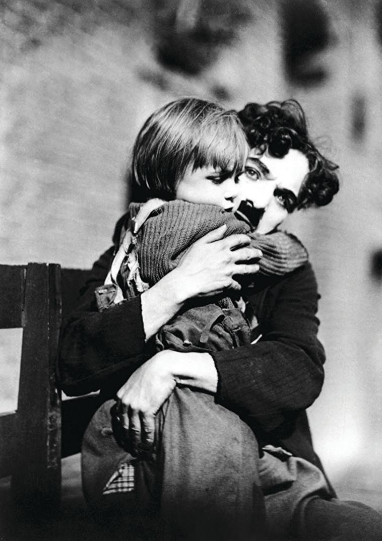 "צ'רלי צ'פלין, ""הנער"", 1921.  IMDB"