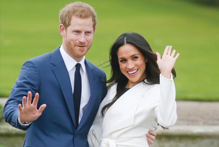 הנסיך הארי ובת זוגו מייגן מרקל . AFP