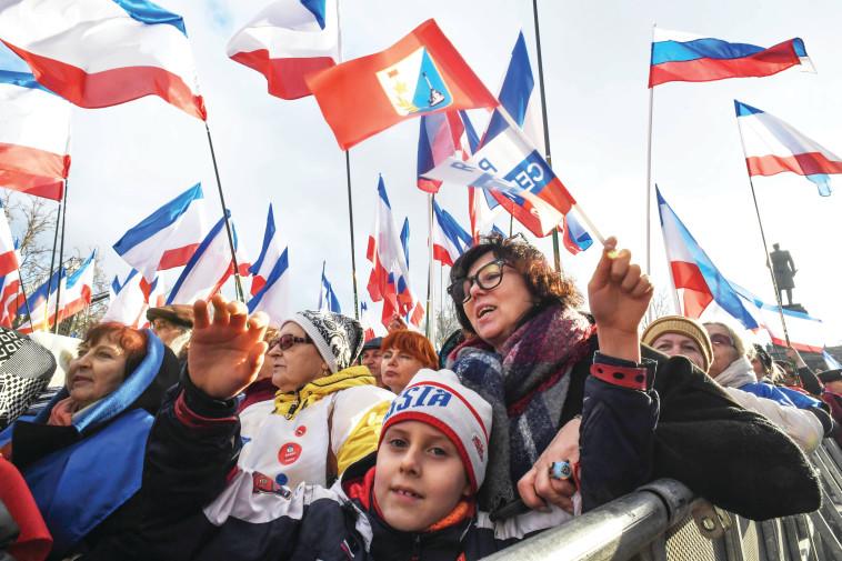 עצרת תמיכה בפוטין. צילום: AFP