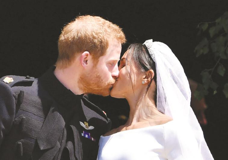 הנסיך הארי ומייגן מרקל ביום חתונתם. צילום: AFP