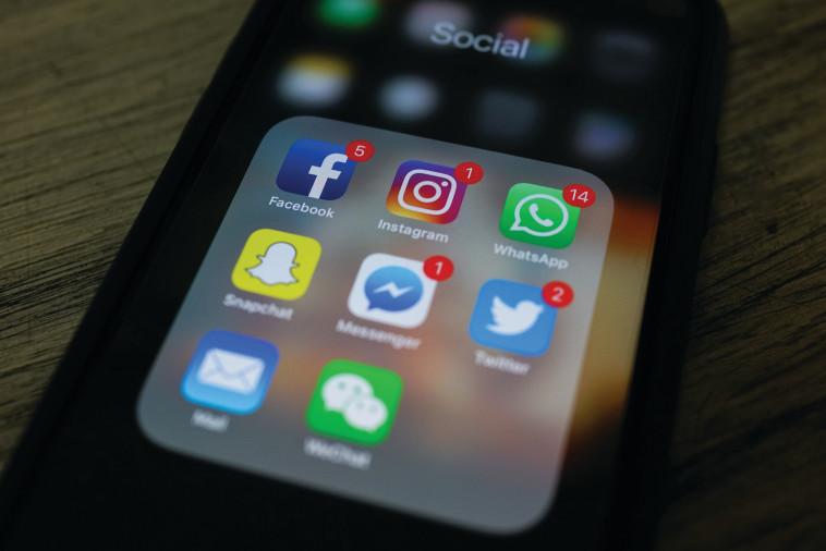 אפליקציות, אילוסטרציה (צילום: AFP)