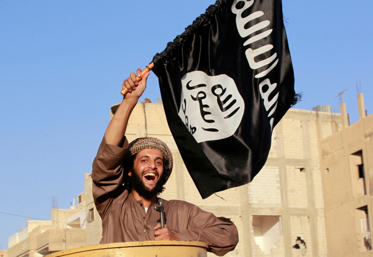 שאפו להקים ח'ליפות אסלאמית. לוחם דאעש, צילום: רויטרס