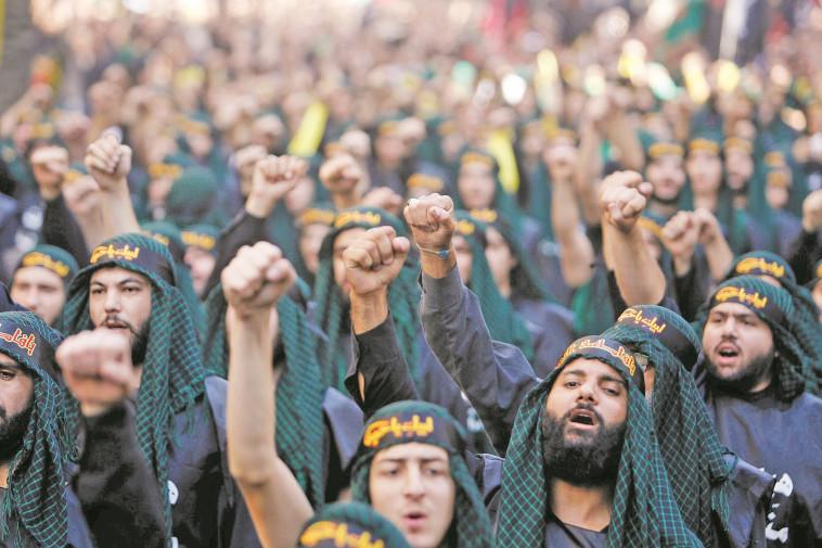 פעילי חיזבאללה (צילום: רויטרס)