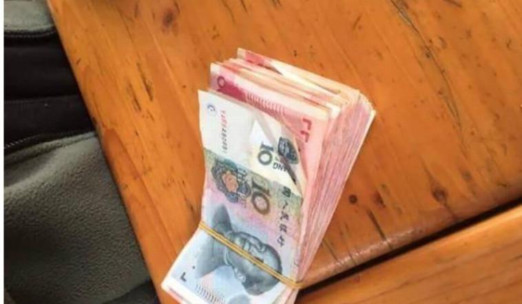 המשטרה מחפשת אחר תייר שהאכיל ג'ירפות בשטרות נייר. צילום מסך