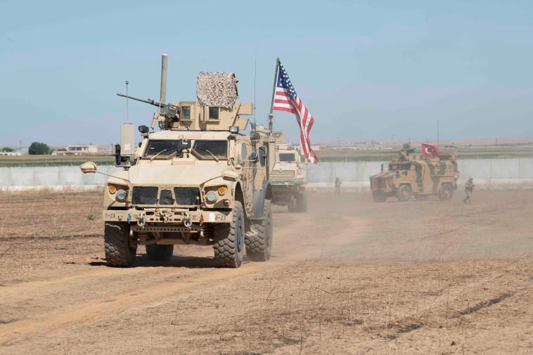 פטרול משותף של כוחות אמריקאים וטורקים בצפון סוריה. צילום: רויטרס