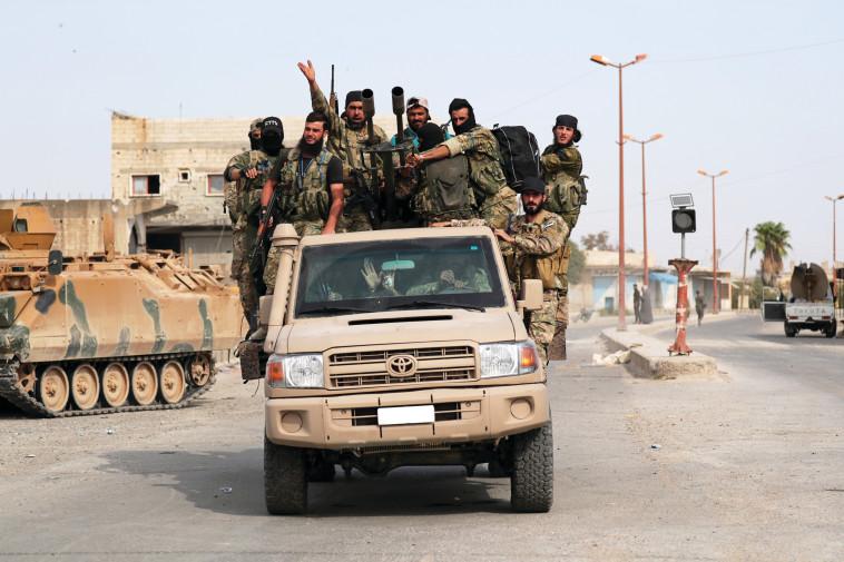 תומכי צבא טורקיה פועלים בסוריה. צילום: רויטרס