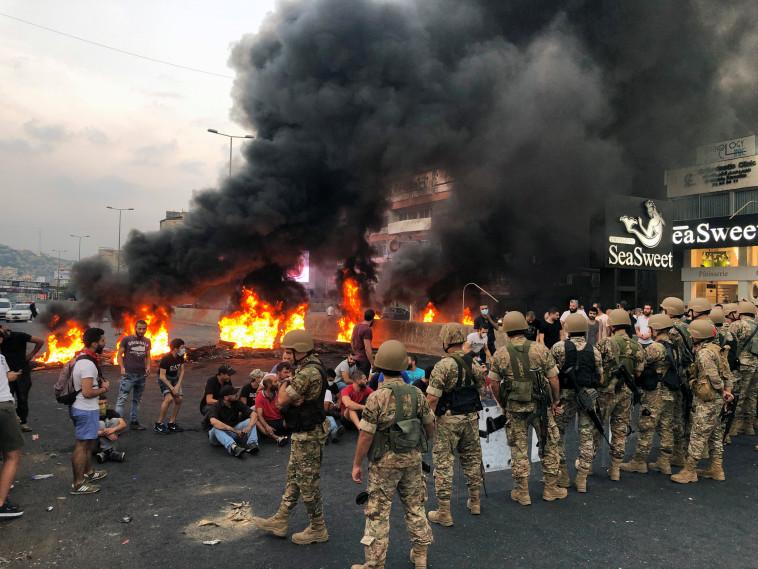 המחאה בלבנון (צילום: REUTERS/Imad Creidi)