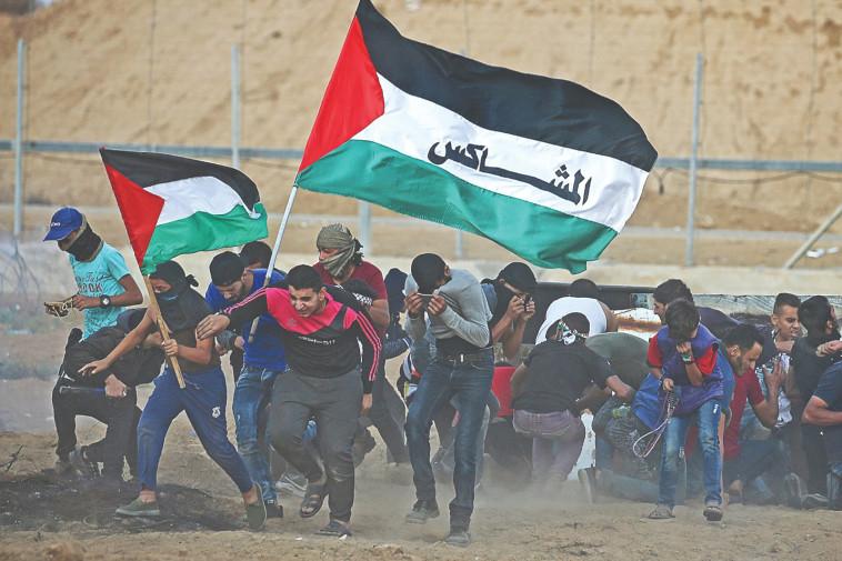 עימותים בגדר רצועת עזה. צילום: רויטרס, איברהים אבו מוסטפא