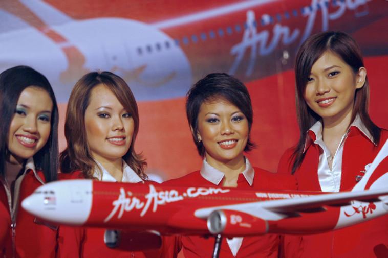 """חברת התעופה """"אייר אסיה"""" (צילום: TENGKU BAHAR/Getty images)"""