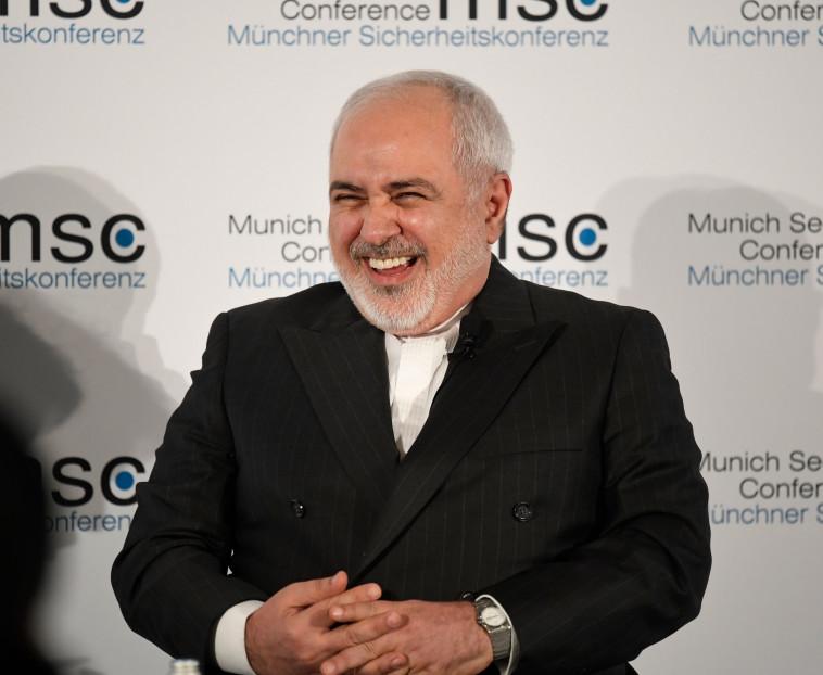שר החוץ האיראני, מוחמד זריף, בועידת מינכן (צילום: THOMAS KIENZLE AFP)