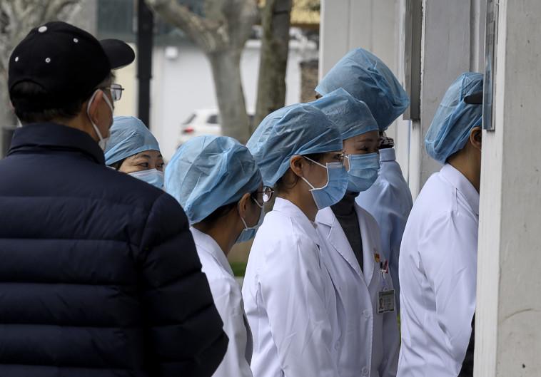 וירוס הקורונה  (צילום: NOEL CELIS/AFP via Getty Images)