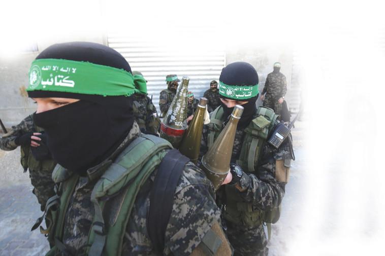 חמושי חמאס (צילום: SAID KHATIB/AFP)