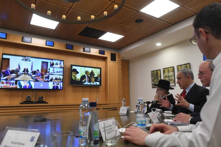 נתניהו בשיחת הוועידה (צילום: קובי גדעון, לע''מ)