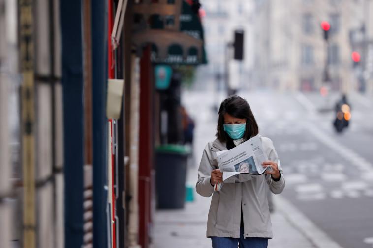 קורונה בפריז (צילום: REUTERS/Christian Hartmann)