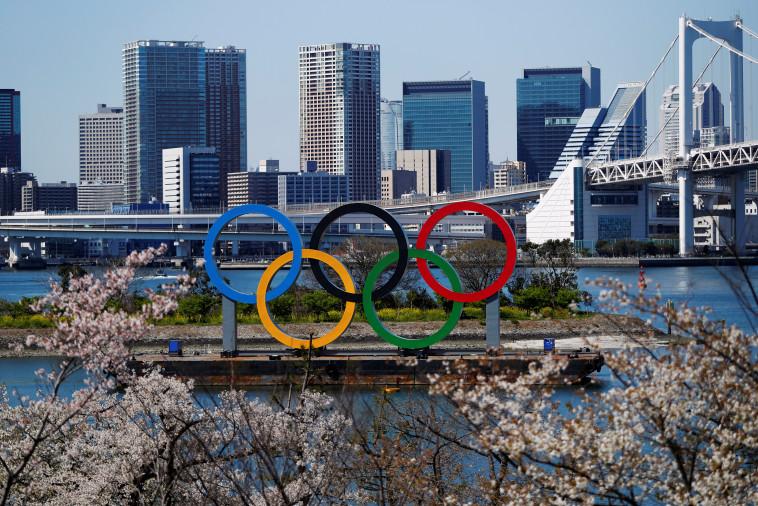 בצל הקורונה - האולימפיאדה נדחית בשנה  (צילום:  REUTERS/Issei Kato)